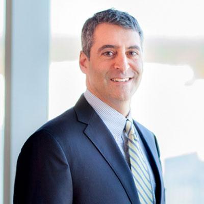 Attorney Jeff Kadis standing in front of window