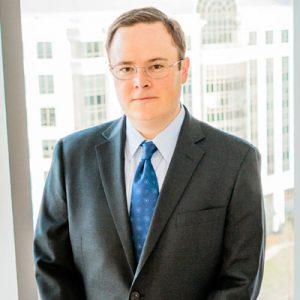 Ryan Keevan wearing gray suit and blue tie