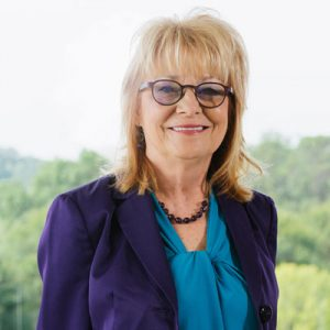 Attorney Linda Stephens standing in front of window