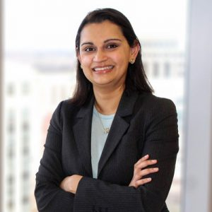 Deepa Winebarger wearing a dark suit and blue shirt